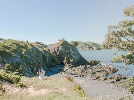 Newlyweds walk down to beach